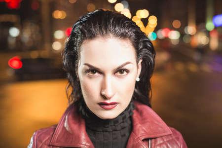 Lady vamp portrait on a city bokeh background