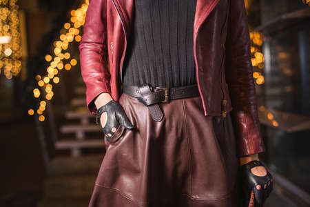 Woman with leather belt and gloves fashion look Reklamní fotografie