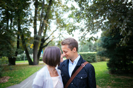 Lovers are walking in the park hugging and kissing Reklamní fotografie - 56447477