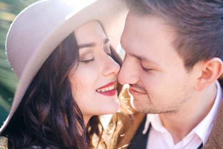 Young elegant fashion couple kissing