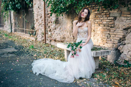 Bride fashion with romantic flower bouquet in Rome