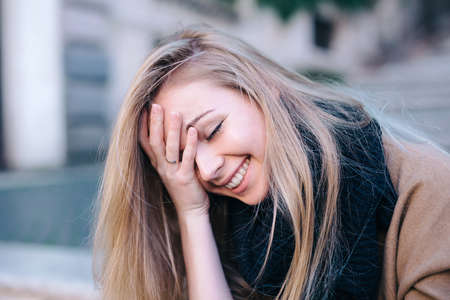 Blonde young woman smiling laughing fashion emotional
