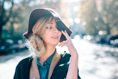 Blonde woman dreaming in hat closeaup fashion outdoors lifestyle Reklamní fotografie