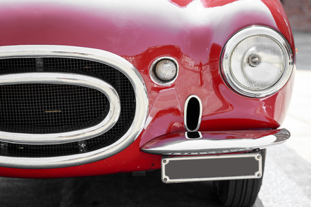 vintage cars: close-up of front of a red vintage car