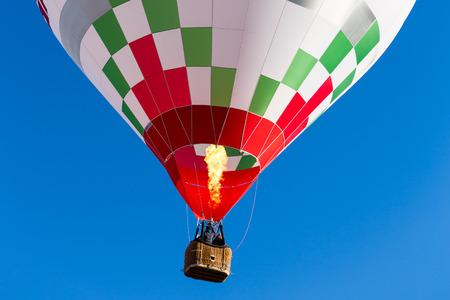 hot air: detail colorful hot air balloon in flight flame propane