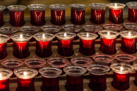 votive: Many red votive candles Stock Photo