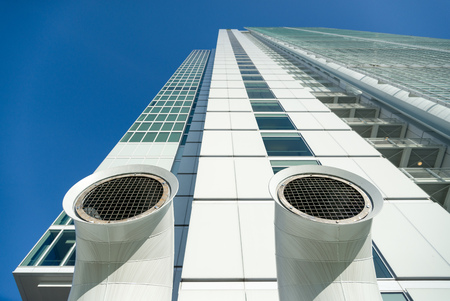 venting: close up of two ventilation chimneys painted steel Stock Photo