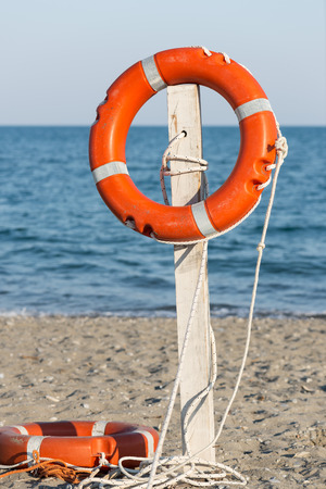 life preserver: Life preserver on sandy beach