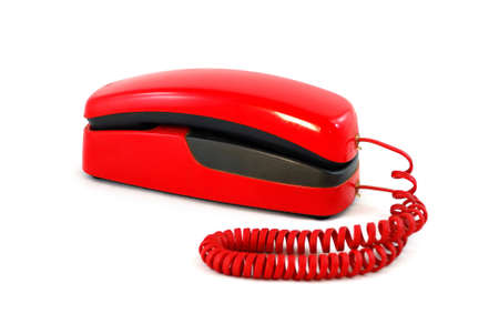Old red phone on white background