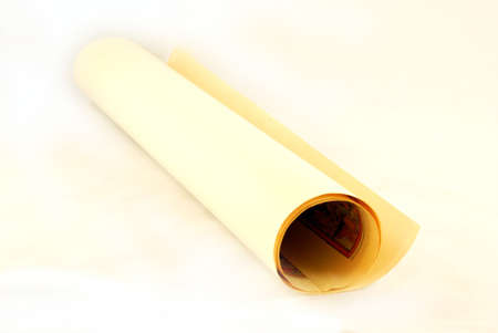Roll of paper with old map on a white background