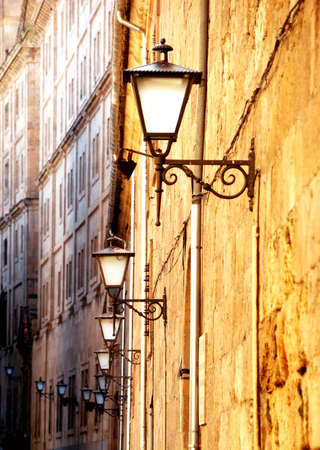 Old street lined with lanterns. Sunset Light photo