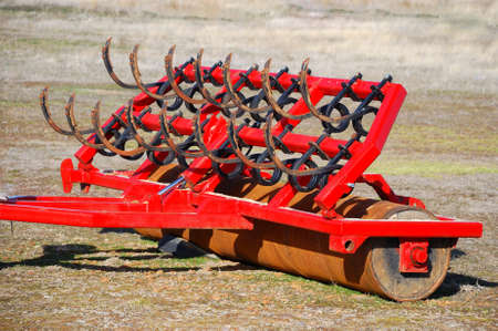 flatten: Red farm tool used to remove and flatten the farmland