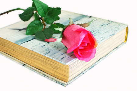 Hardcover book with a rose in top