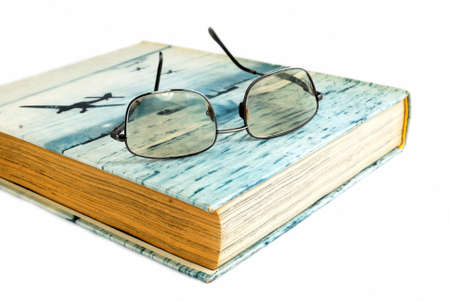 suggests: Book and  glasses on white background  culture and leisure suggests