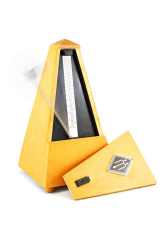 Old wood metronome with a moving indicator Stock Photo - 13338367