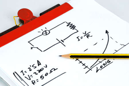 Notepad, pencil and a little schematic of Ohm