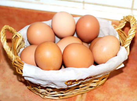 Basket of blond Eggs in the kitchen of the farm