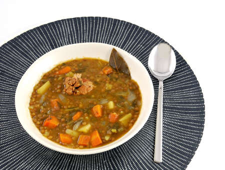 bay leaf: Dish of stewed lentils with meat, bay leaf and carrot  Stock Photo
