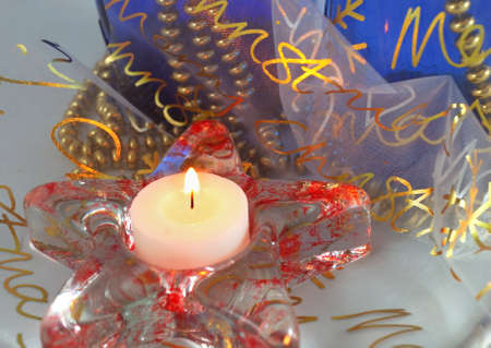 Christmas candle with blue and gold background photo