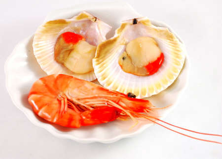 Prawn and red clams  Snacks on porcelain shell