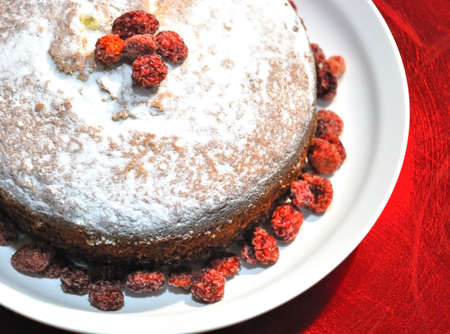 Great cake with powdered sugar and fruits  Stock Photo
