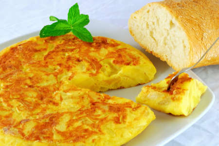 Spanish omelette made with eggs and potatoes  With bread  Stock Photo