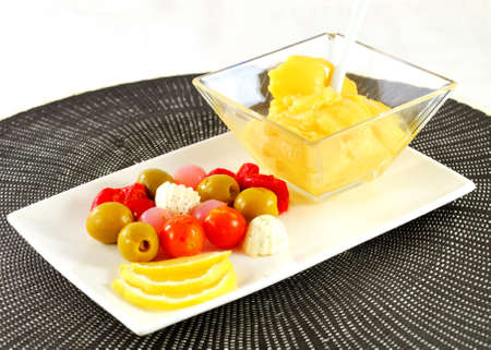 Olives appetizers with cherry tomatoes and cheese
