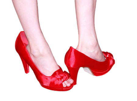 Small foot in too high red shoes