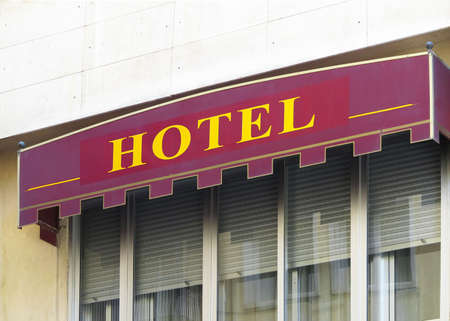 Label Hotel in red color and yellow