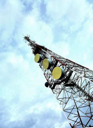 Tower of communications on top of a mountain under cloudy blue sky Stock Photo - 18378448