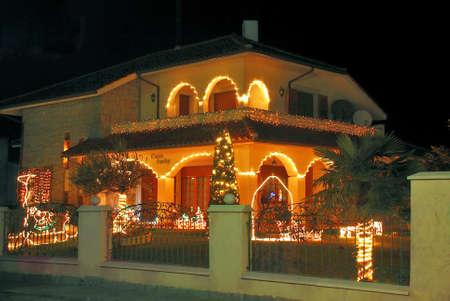 home lighting: Christmas lighting in the home and garden. Figures lit.