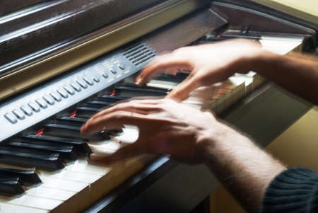 cadence: Keyboard of piano and moving hands