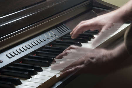 allegro: Keyboard of piano and moving hands