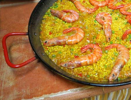 Spanish rustic rice, paella with seafood Stock Photo