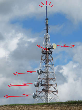 electronica: Communications tower with red ray in the meadow Stock Photo