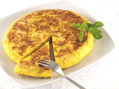 Spanish omelette made with eggs and potatoes photo