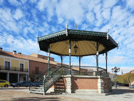 Music kiosk in village over cloudy blue sky