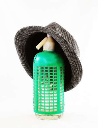 Green seltzer with gray hat old and obsolete Stock Photo