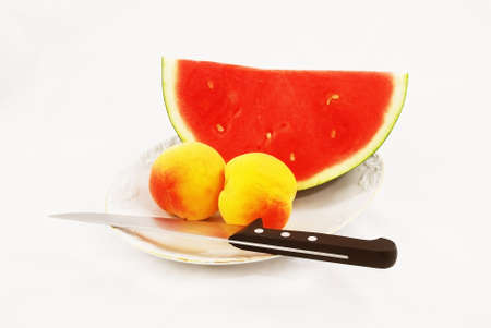 Great piece of watermelon with knife amd peaches