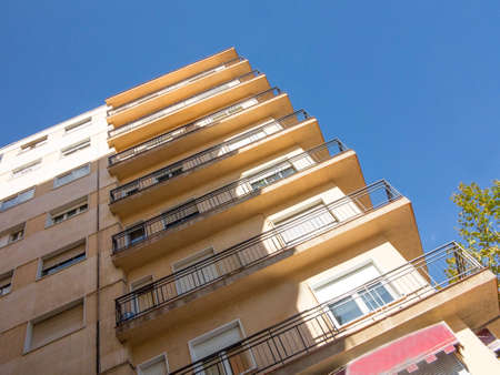 Residential building of many floors with balconies Editorial