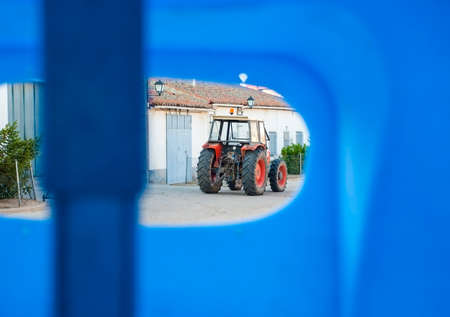 Tractor in blue, park in front his house