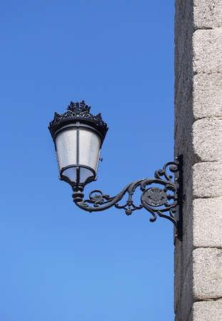 Streetlight black color backlit on a blue sky Stock Photo