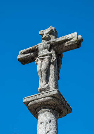 Stone cross on blue sky from middle age