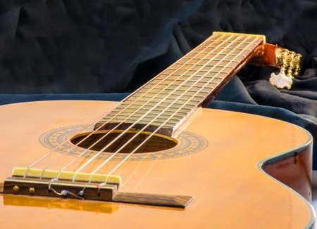 Flamenco guitar horizontal view on blac