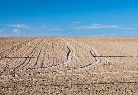 Freshly plowed field in the meadow