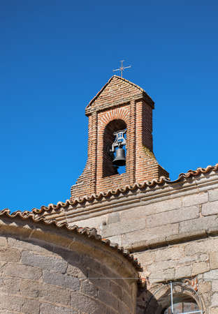 Bell tower with a bell on blue sky Stock Photo
