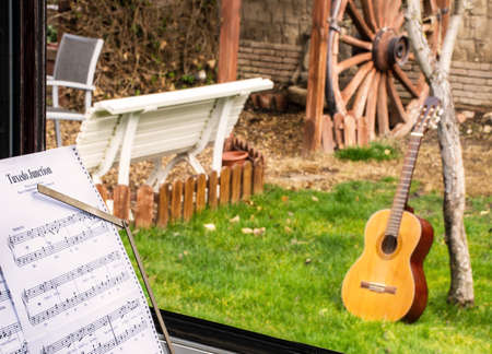 sheet music: Sheet music and guitar trough the windows