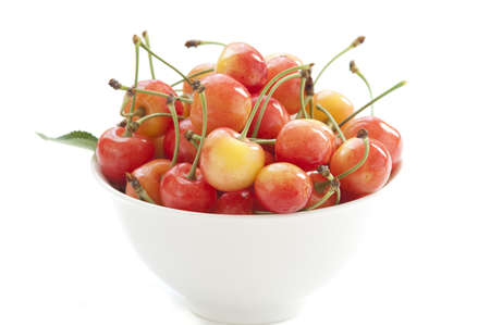 White bowl with sweet cherries