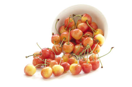 Sweet cherry in a white bowl Stock Photo