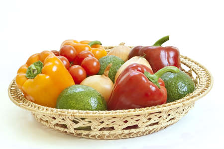 Fresh vegetables in a basket on white background Stock Photo